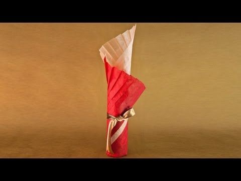 This video tutorial shows how to gift wrap a wine bottle in a fashionable Japanese pleating style. Featured in the holiday advertisement for Nanbu Bijin Sake...