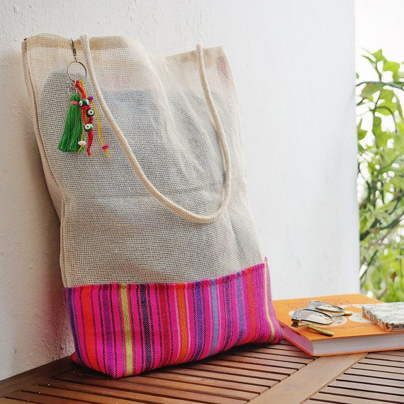 Cancun favor bag  * Cambaya fabric comes in a bunch of different colors and patterns. Send a convo to see the Cambayas we are working at the time :)  Planning a destination wedding? Treat your guests with this favor bag made of jute and Cambaya, a typical mexican fabric. Cambaya comes in a ton of different colors and patterns; you can see some examples in the last photo. If you have certain colors you prefer, just send a convo and Ill show you the existing fabrics :)  We added a gusset at…