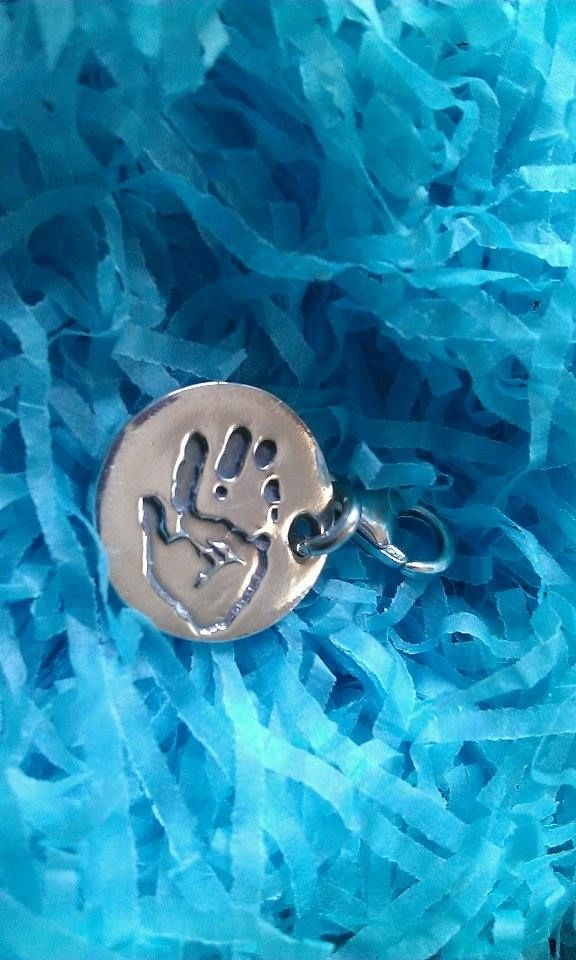 Daughters Handprint on a lovely charm for a very special grandad.