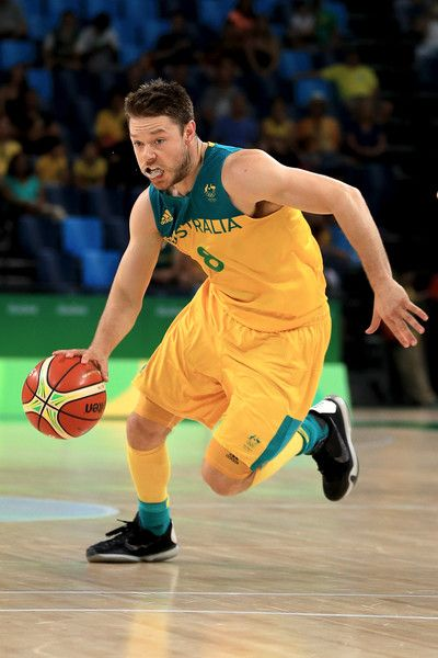 Matthew Dellavedova Photos - Matthew Dellavedova #8 of Australia drives the ball against Lithuania during the Men's Quarterfinal match on Day 12 of the Rio 2016 Olympic Games at Carioca Arena 1 on August 17, 2016 in Rio de Janeiro, Brazil. - Basketball - Olympics: Day 12