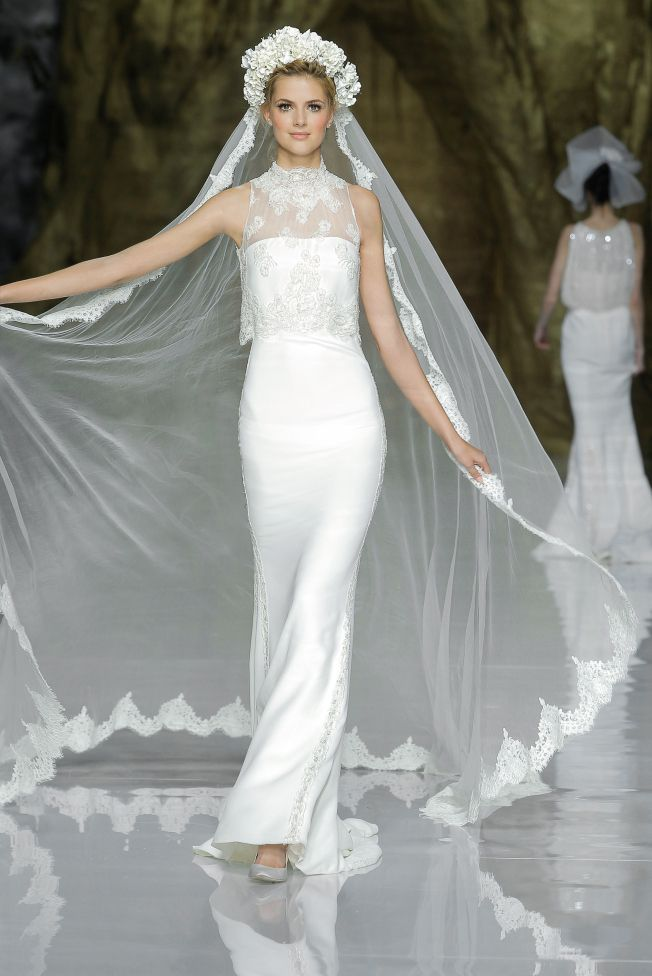 Pronovias Wedding Dress // The Russian-inspired headdress and enormous veil is so dramatic in contrast with the slender sheath frame. Stunning.