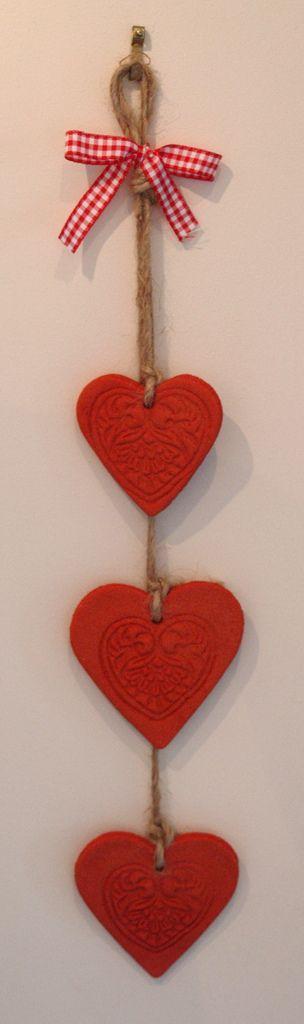 Red salt dough hearts - a trio of them.