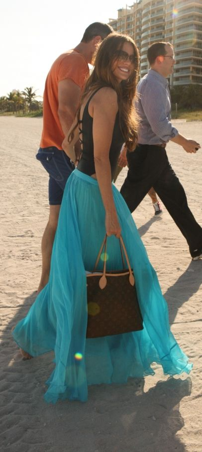 Sofia Vergara hits the sand with fiance Nick Loeb at hand in South Beach.
