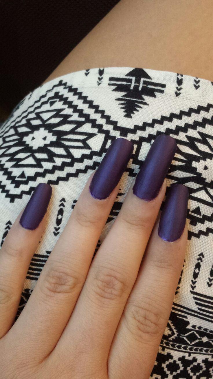 Acrylic nails and lovely purple nail polish whit a matte topcote