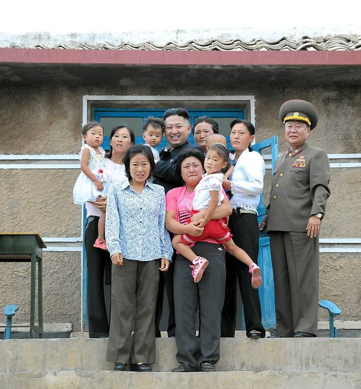 Kim Jong Un Family Photo: North Korean Leader Poses With Terrified-Looking Family