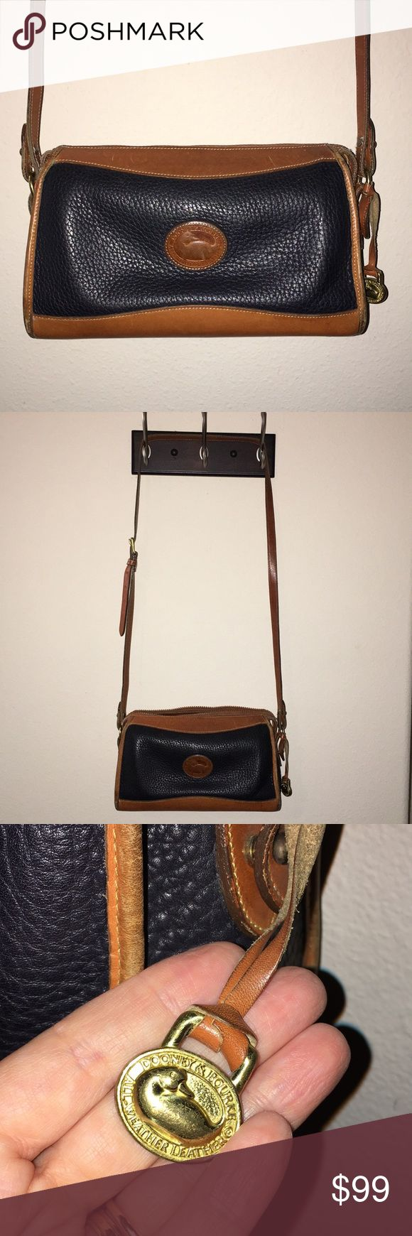 """Vintage DOONEY & BOURKE Tan Navy Crossbody Bag This is a Vintage DOONEY & BOURKE Tan and Navy Shoulder Bag Purse with original hangtag charm fob included! Measures about 11""""x6"""", good used condition!  I ship fast! Happy poshing friends! Dooney & Bourke Bags Crossbody Bags"""