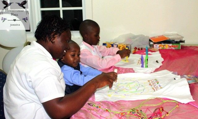 T-shirt painting for children at the Kidz Zone of Hummingbird Hall Jamaica destination weddings in Rose Hall, Montego Bay, Jamaica.
