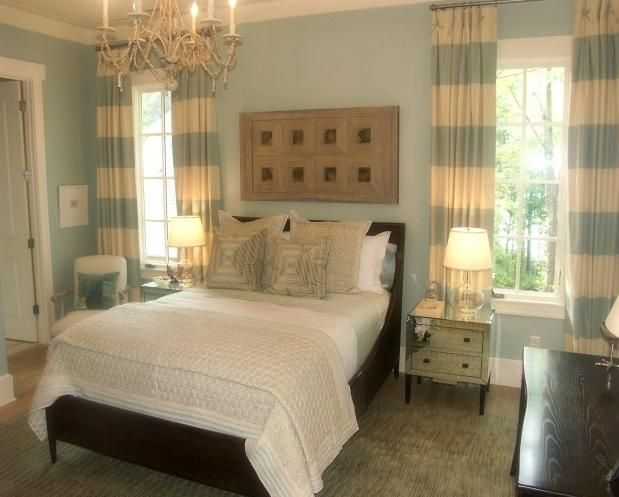 Espresso furniture light blue walls striped curtains white bedding tan accents a gorgeous Master bedroom light blue walls
