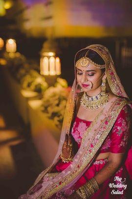 Bridal Portriat - Shivam & Purva | WedMeGood | Bride in a Fuchsia Pink Lehenga with a Light Pink Net Dupatta and a Polki and Gold Set #wedmegood #indianbride #indianwedding #bridalportrait #portrait #bridal #pink #lehenga
