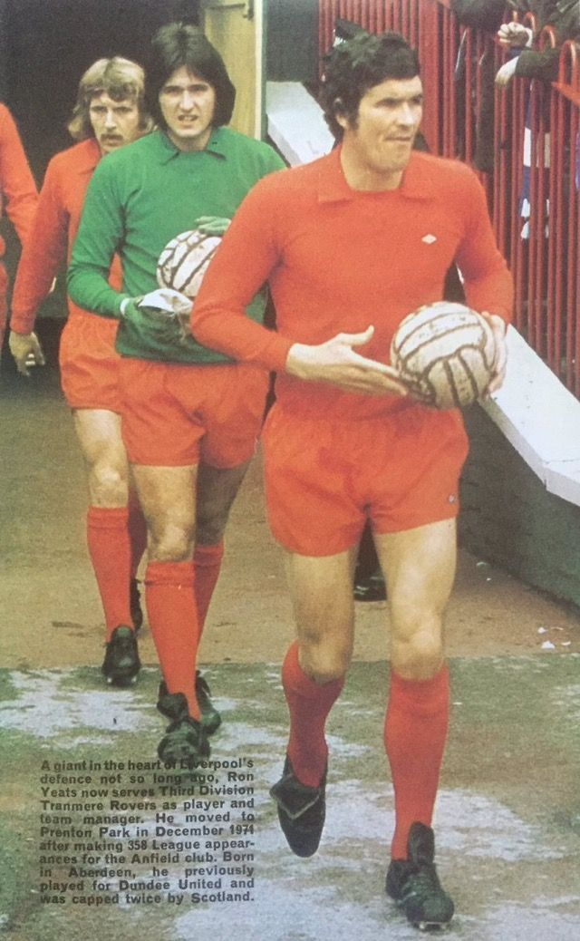 Tranmere Rovers captain Ron Yeats leads his new team out in 1975.