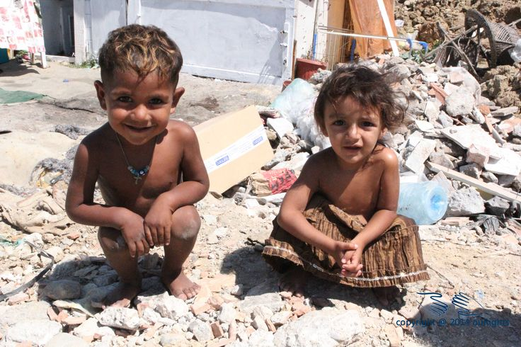 Children in the slums of Tirana living in dirty conditions.
