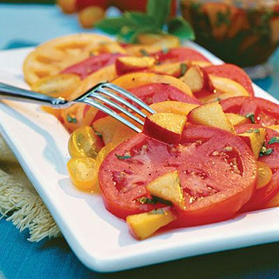 Sliced Tomatoes With Fresh Peach-Basil Vinaigrette.