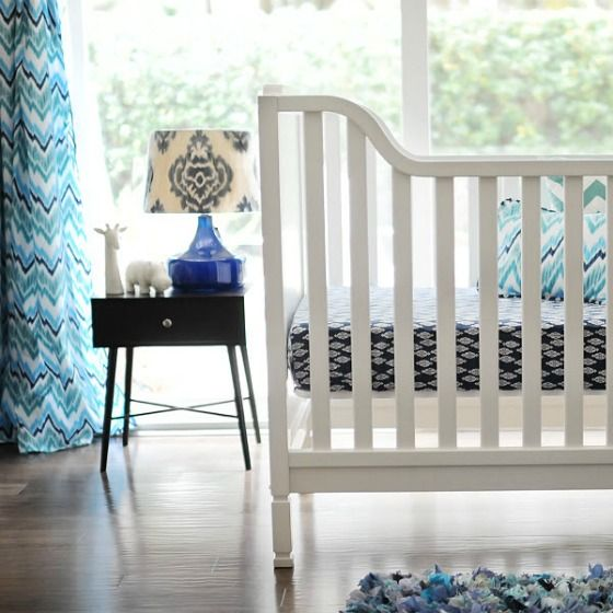 This #navy crib bedding is so clean with #white furniture and some #turquoise accents.  #cribbedding