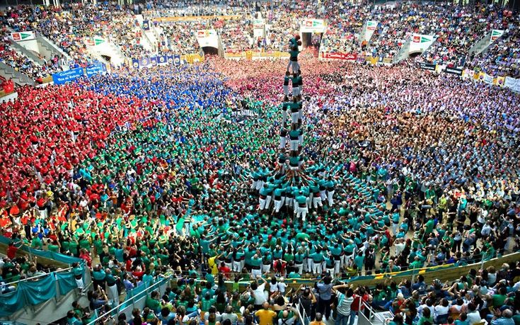Members of the Colla Castellers de Vilafranca construct a human tower during the 24th Tarragona Castells Competition in Tarragona, Spain.