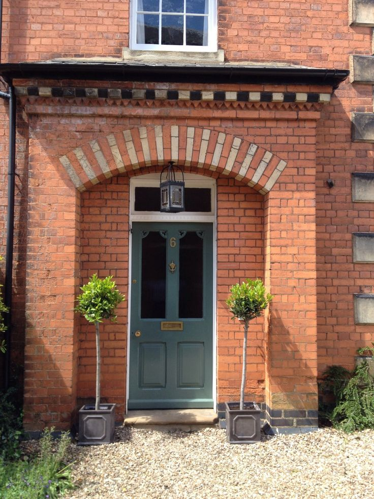 Front door painted in Farrow and Ball's Green Smoke
