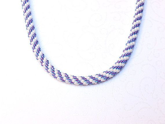Bluish purple and white beaded necklace with spiral pattern