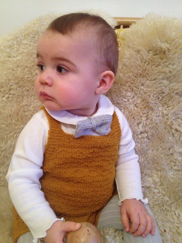 Knitted bow tie. No pattern, made up while knitting. Also knitted the yellow romper suit.