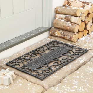 Make your guests feel super welcome this weekend with this door mat from Next.