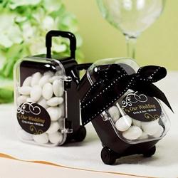 http://www.beau-coup.com/mini-rolling-suitcase-favors.htm