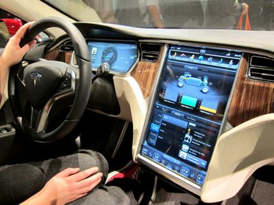 Tesla Model S - Fully electric luxury sports car able to go ~300 miles on a single charge, and gets to 60 in about 4 seconds...Oh, and did you see that 17 inch touch screen!