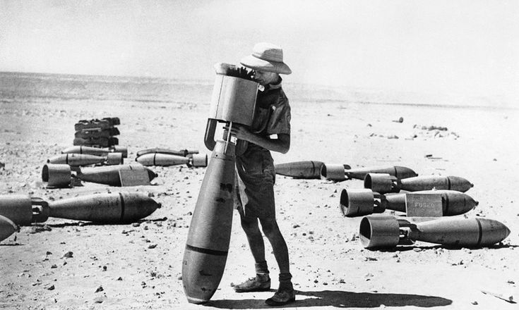 This armorer of the R.A.F.'s middle east command prepares a bomb for its mission against the Italian forces campaigning in Africa. This big bomb is not yet fused, but when it is it will be ready for its deadly work. Photo taken on October 24, 1940. (AP Photo)