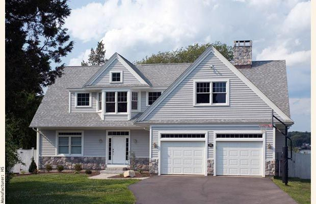 Cape cod house garage in front an achitect designed cape for Garage with dormers