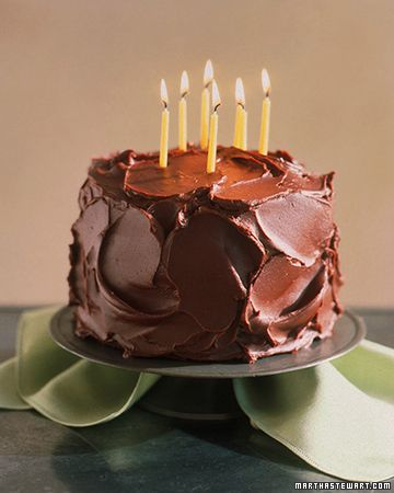Moist Devil's Food Cake.     Great swoops of glossy frosting make this a wonderfully exuberant cake with a dark backdrop for birthday candles. But this cake is just as suitable for afternoon snacks or a Sunday supper.
