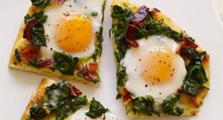 Applewood Bacon and Eggs Breakfast Flatbread: Pizza for breakfast? This upscale breakfast pizza features a naan flatbread crust, candied bacon, spinach, Gruyere cheese and sunny-side up eggs.