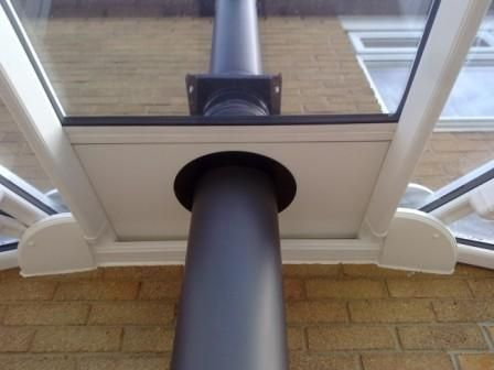 flue through conservatory roof