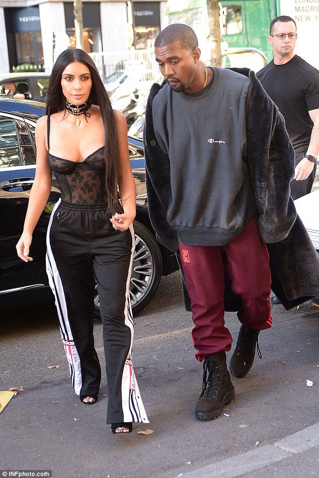 Odd combination: Kim Kardashian steps out in Paris with Kanye West on Thursday in a strange combination of corset and tracksuit bottoms, ahead of the Balmain Show
