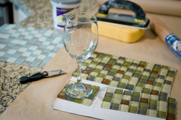 DIY coasters, using glass tile. We have backsplash tiles left over!! Now our coasters will match the kitchen!!