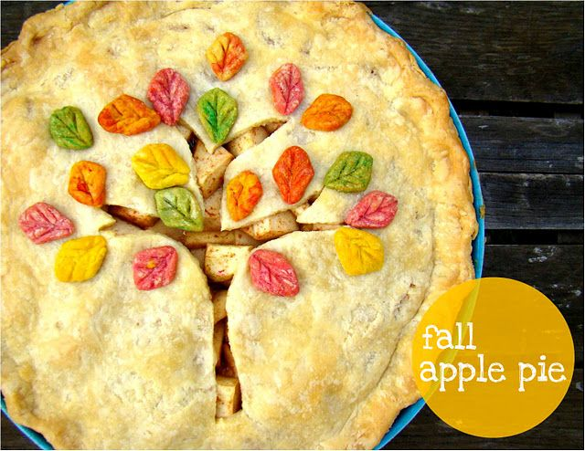 Festive Fall Apple Pie with a tree and leaves in all the fall colors to decorate the top.