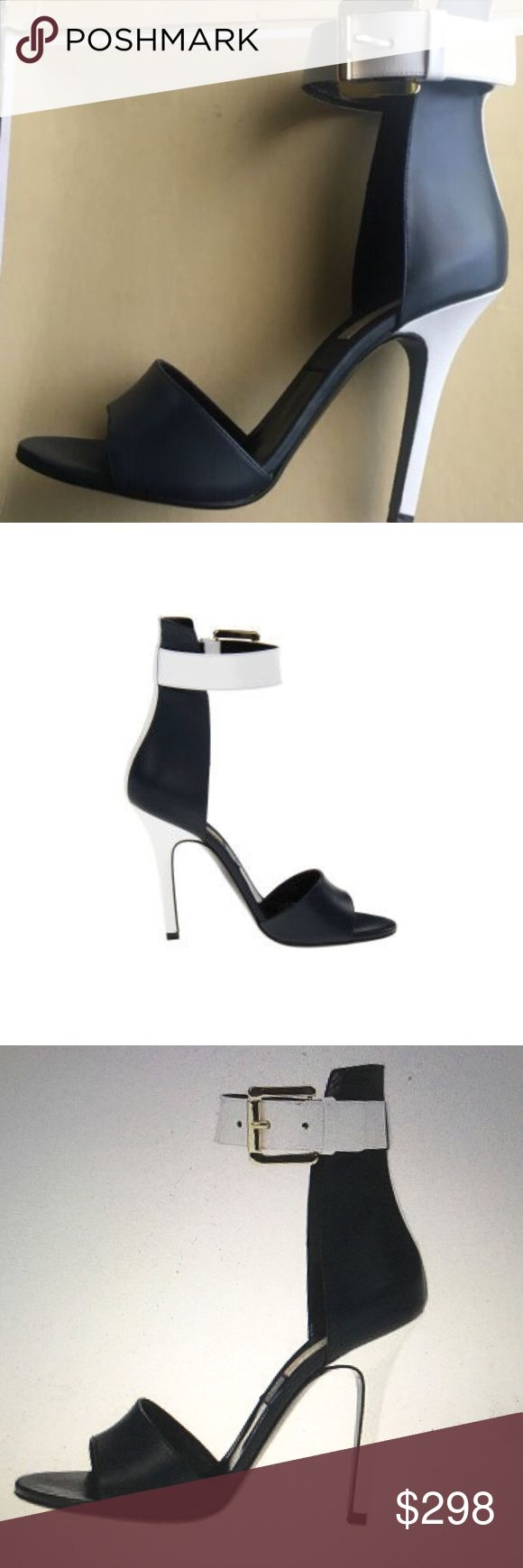 Michael Kors MK20181 Two Tone Heels Two-tone leather upper Ankle strap with a buckle closure Striped back Set-under stiletto heel Leather lining Leather insole Leather outsole Made in Italy. Heel Height: 3 3/4 in Box is damaged, no dustbag Michael Kors Shoes Heels