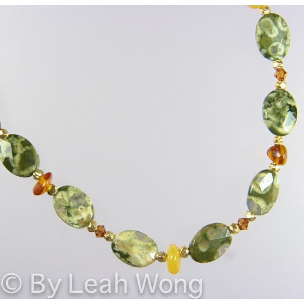 This necklace is a example of how beautiful things that come from nature can be. It is made of rhyolite jasper and different colors of amber. $49.00