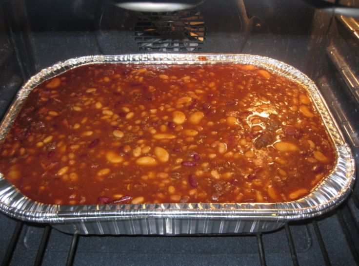 Four Bean Baked Beans With Ground Beef by Rose  I do not add white sugar.  You may need to increase brown sugar.  Add a few drops of liquid smoke and omit chili powder.  Bake at 275 for 5 houea.  For a meal, top with hot dogs for last hour of cooking and serve with slaw or a salad.  Have rolls ready for dogs.