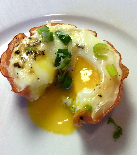 Line muffin tin with ham, crack an egg, bake @ 400 for12 mins, sprinkle with Parmesan