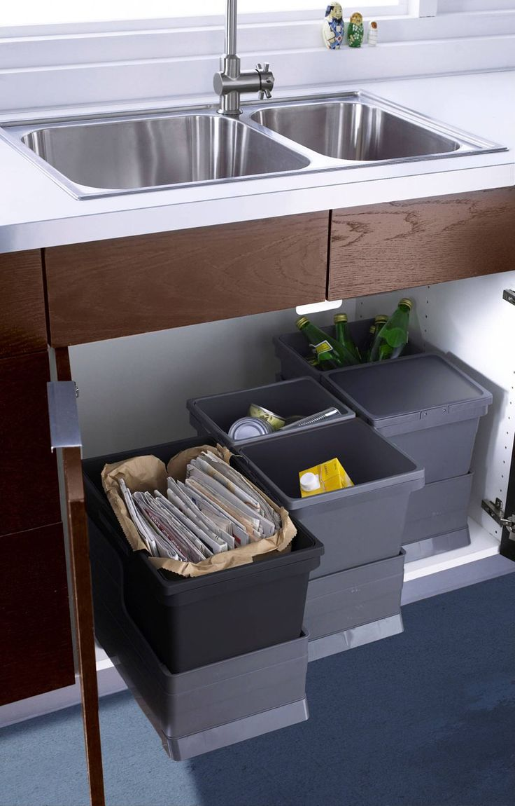Kitchen Design Idea - Hide Pull Out Trash Bins In Your Cabinetry | These bins are all on individual sliders under the sink so you only pull the one you need when you need it.
