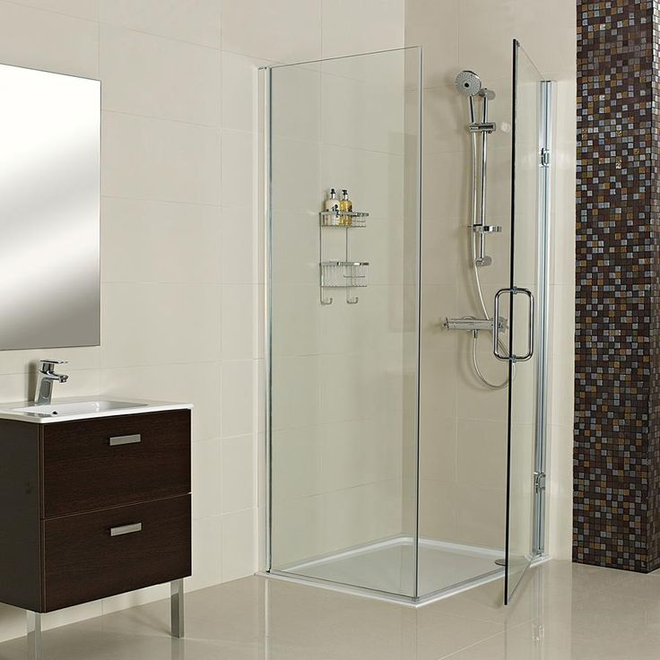 Decem Hinged Door with Side Panel for Corner Fitting--- Our Decem range presents an elegant Shower Enclosure for a corner installation, designed to create an effortlessly minimalist finish.--- Available from Roman Ltd - British Made Luxury Shower Enclosures and Bath Screens. Images Copyright www.roman-showers.com