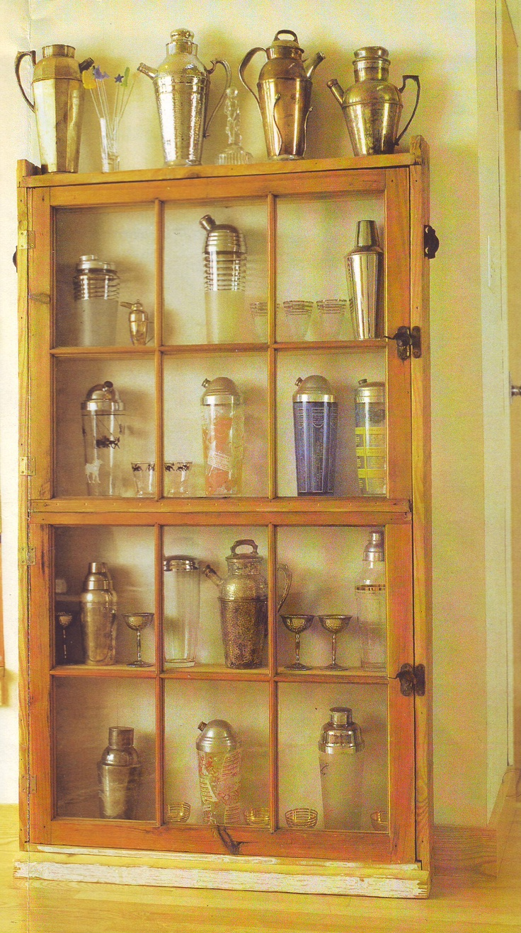 two old casement windows and window sashes turned into a curio cabinet  (I have detailed assembly instructions if anybody wants them!)
