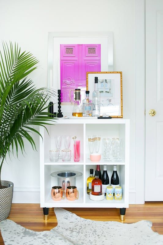 Bar carts are entertaining secret weapons: 1) They free up kitchen storage from all those liquor bottles; 2) they encourage guests to help themselves; and 3) when styled nicely, they just look so festive, sparkly, and adult-ish —they are party decorations on wheels