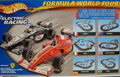 Tyco Mattel Hot Wheels Formula World Tour Slot Car Racing Set W/ 2 Cars TYC95715:   Tyco Mattel Hot Wheels Formula World Tour Electric 6 In 1 Racing Set. Includes: 2 Formula One Slot Cars:1 red Shell Ferrari F1 ## and 1 white Mobil McLaren F1 #1 2 Hi-Performance Controllers 16 Track Pieces 19 Accesories 1 Decal Sheet Hi-Performance Power Pack More Than 11 Feet Of Track This slot car set is brand new in original package