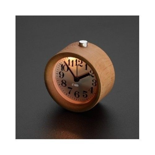 This Wood Alarm Clock is a mini version of the popular large round Wood clock. It is small yet beautifully crafted this clock can sit on a table . Your guests will admire the Wood Alarm Clock simple yet attractive design. This beautiful wooden clock will add a touch of contemporary rustic charm to any room. Its minimalistic form and function is simplicity at its best and compliments virtually any decor. Wood is composed of various blended elements giving each its own unique subtle fragrance.