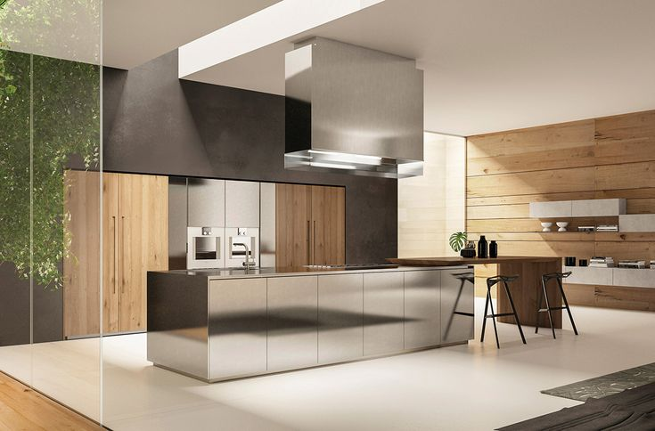 Stainless Steel, texturized natural oak wood with embossed handle and microcement: contrasting materials for a technical and inviting ambiance