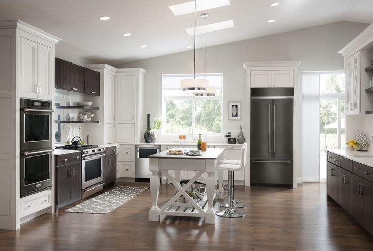 KitchenAid's refrigerator, oven, and dishwasher are all available in black stainless steel. The black stainless appliances complement traditional stainless pieces, and the two can be mixed and matched in a kitchen. Photo 5 of 8 in New Kitchen Materials You Should Know About