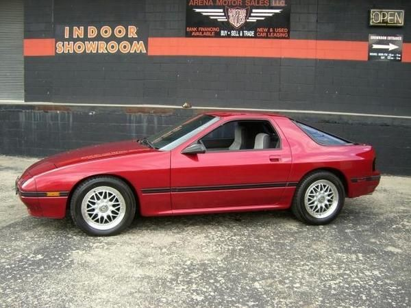 1987 mazda had a blue one mine my husbands car purchase two kids in car seats