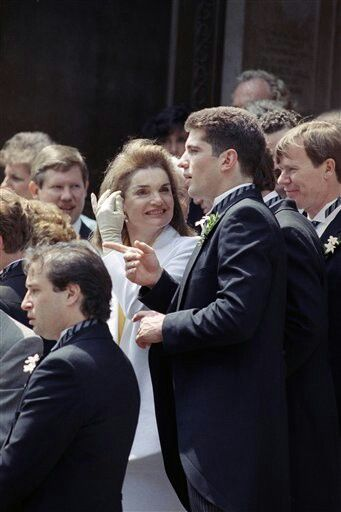 Jackie Kennedy Onassis talks with her son, John Kennedy Jr., outside St. Matthew's Cathedral in Washington, June 9, 1990 following the wedding of Kerry Kennedy and Andrew Cuomo.