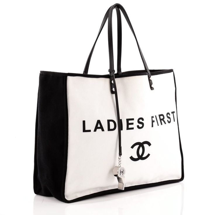 Online Sale - Authentic White Chanel Ladies First Whistle Tote Canvas Large at Trendlee.com. Guaranteed genuine! Financing available. 650401