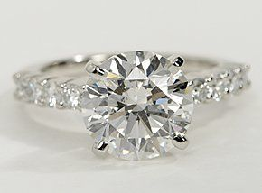 Beautifully striking, this diamond engagement ring crafted in platinum showcases ten carefully-matched round diamonds to frame your center diamond. Setting includes ½ carat total diamond with a 3.8 carat solitar.... No big deal