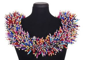 23-Apr- 26-Apr-2015 Smithsonian Craft Show, Washington, DC - Category: Wearable Art  Artist: DANIELLE GORI-MONTANELLI  Millions of Pencils Collar Description: Hand cut and assembled wool felt. Dimensions: H:18.00 x W:18.00 x D:4.00 Inches