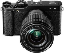 "Fujifilm X-M1 Review - The Fujifilm X-M1 is a lightweight compact system camera featuring a retro design that bears more than a passing resemblance to its bigger brothers, the X-E1 and the X-Pro1. At the heart of the X-M1 is the same 16.3 megapixel APS-C sized ""X-Trans"" CMOS sensor, which has a colour filter array that mimics film grain and no optical low-pass filter for higher resolution images."